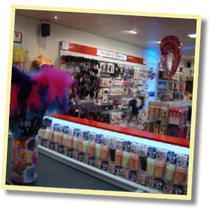 Lovers Adult Stores interior photo showing fluffy ticklers and a wall of adult toys